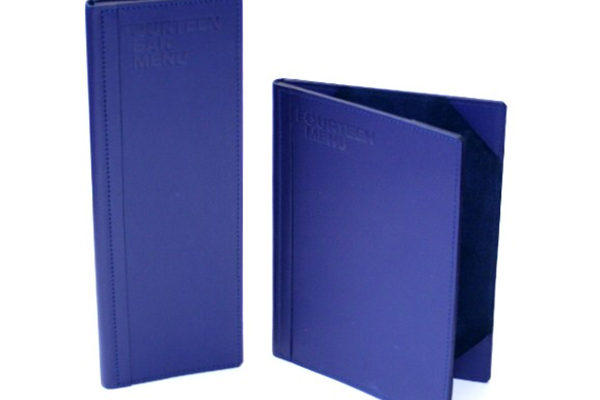 This set of menus was created for PWC in London, for the in house dining room for clients. We used a special leather from the USA to create a set of stunning menus. We used a matching blue suede for the lining with corner mounts to create the highest possible quality. We used a hot foil stamp with a clear varnish to indent the logo into the front covers.
