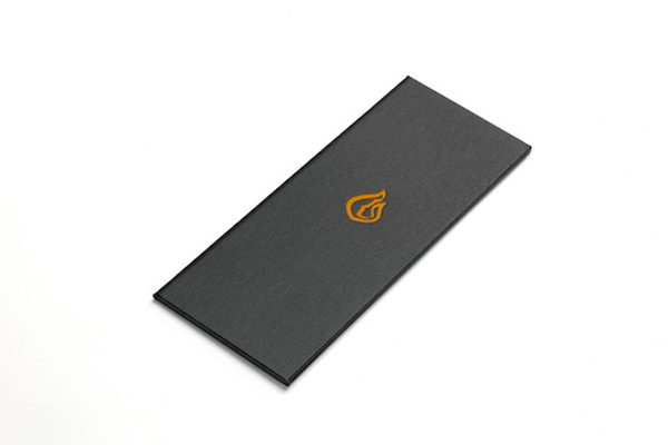 Buckram covered menu cover  with orange indented logo, created for Jamie Oliver's restaurant in London The Fire Station.