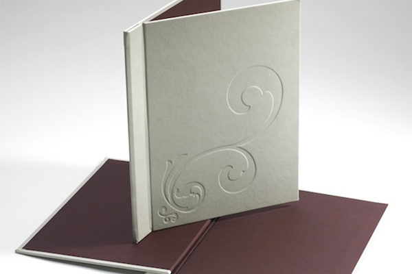 Embossed menu cover design on a 3000 micron board, elastic located inside the spine to hold A4 pages. De-bossed pattern on cover is set into the material covering offering longevity and easy cleaning.