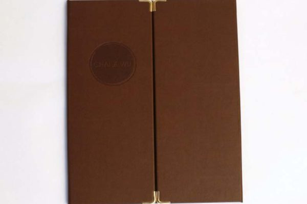 This menu was made for Chai Wu an asian fusion venue in Harrods. Nice bonded leather with brass corners and circular de-bossed logo.