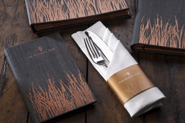 Super cool menus for a hotel bar. We used a brand new material with a copper foil block to add the reed effect.