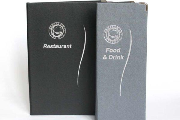 Two sizes of menus for Grosvenor casinos. Metallic Buckram, Silver Foil blocked logo. Metal corners for longevity. A4 menu cover and Cocktail sized drinks menu.